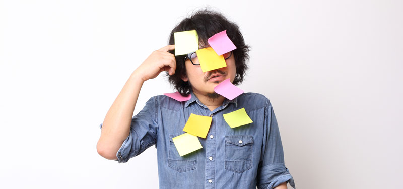 japanese man with notes on his face for keywords